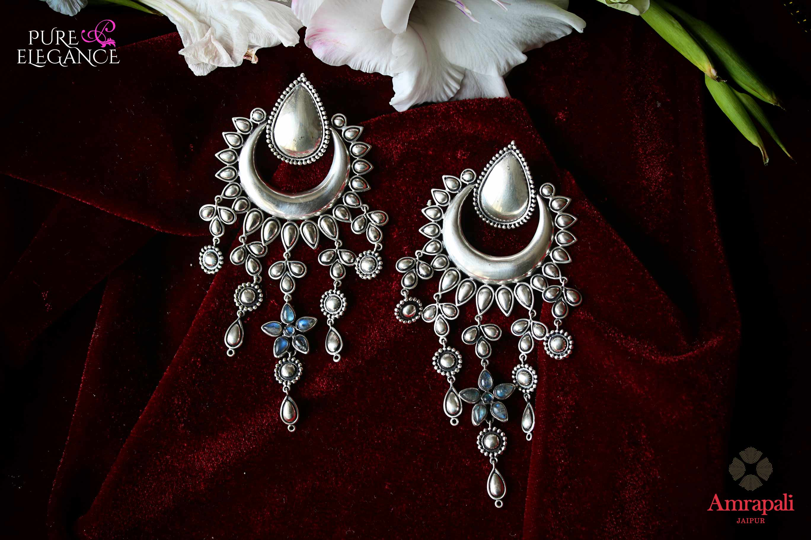 Shop Amrapali silver earrings with tassels online in USA. Find an exquisite collection of handcrafted Indian jewelry in USA at Pure Elegance Indian fashion store. Complete your festive look with beautiful silver gold plated necklaces, silver gold plated earrings, silver jewelry from our online store.-flatlay