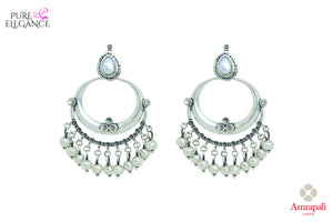 Shop Amrapali silver chandbali earrings with pearl drops online in USA. Find an exquisite collection of handcrafted Indian jewelry in USA at Pure Elegance Indian fashion store. Complete your festive look with beautiful silver gold plated necklaces, silver gold plated earrings, silver jewelry from our online store.-front