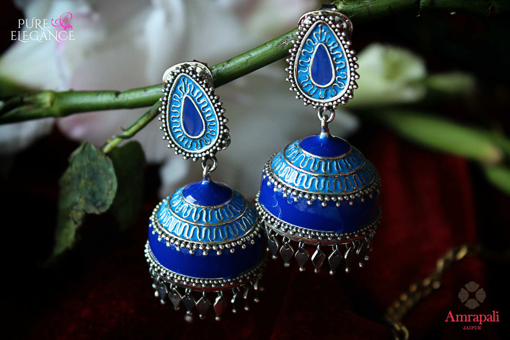 Shop beautiful Amrapali silver blue enamel jhumki earrings online in USA. Find an exquisite collection of handcrafted Indian jewelry in USA at Pure Elegance Indian fashion store. Complete your festive look with beautiful silver gold plated necklaces, silver gold plated earrings, silver jewelry from our online store.-flatlay