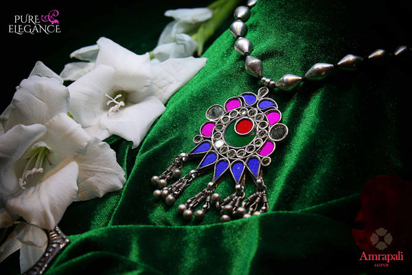 Buy silver dholki thread necklace online in USA with multicolor glass pendant. Get your hands on an alluring range of Indian silver necklaces from Amrapali in USA. Add extra edge to your ethnic look with beautiful silver gold plated jewelry available at Pure Elegance Indian fashion store in USA.-flatlay