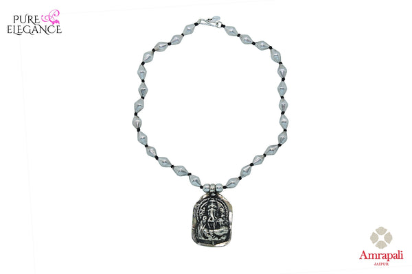Buy Silver Thread Beads Ganesha Necklace online in USA from Amrapali.  If you are looking for Indian silver earrings in USA, then Pure Elegance Indian fashion store is the place for you. A whole range of exquisite of ethnic Indian jewelry is waiting for you on our shelves, you can also opt to shop online.-full view