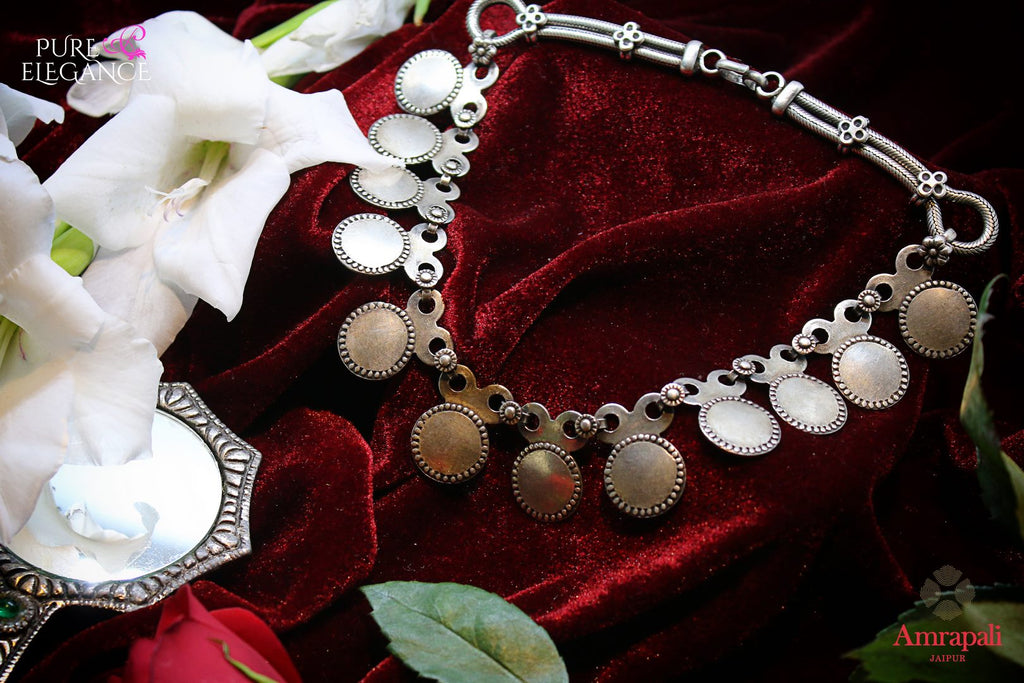 Buy Silver Coin Choker Necklace online in USA from Amrapali.  If you are looking for Indian silver jewelry in USA, then Pure Elegance Indian fashion store is the place for you. A whole range of exquisite of ethnic Indian jewelry is waiting for you on our shelves, you can also opt to shop online.-flat lay