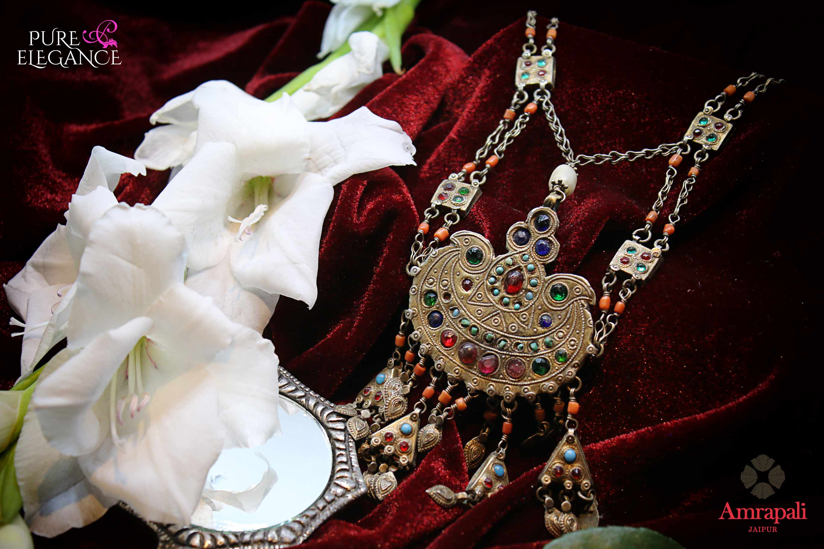 Buy Amrapali silver banjara necklace online in USA with colored glass and beads. Get your hands on an alluring range of Indian silver necklaces from Amrapali in USA. Add extra edge to your ethnic look with ethnic silver jewelry available at Pure Elegance Indian fashion store in USA.-flatlay