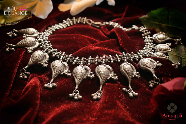 Shop Silver Peacock Motifs Choker Necklace online in USA from Amrapali.  If you are looking for Indian silver jewelry in USA, then Pure Elegance Indian fashion store is the place for you. A whole range of exquisite of ethnic Indian jewelry is waiting for you on our shelves, you can also opt to shop online.-flat lay