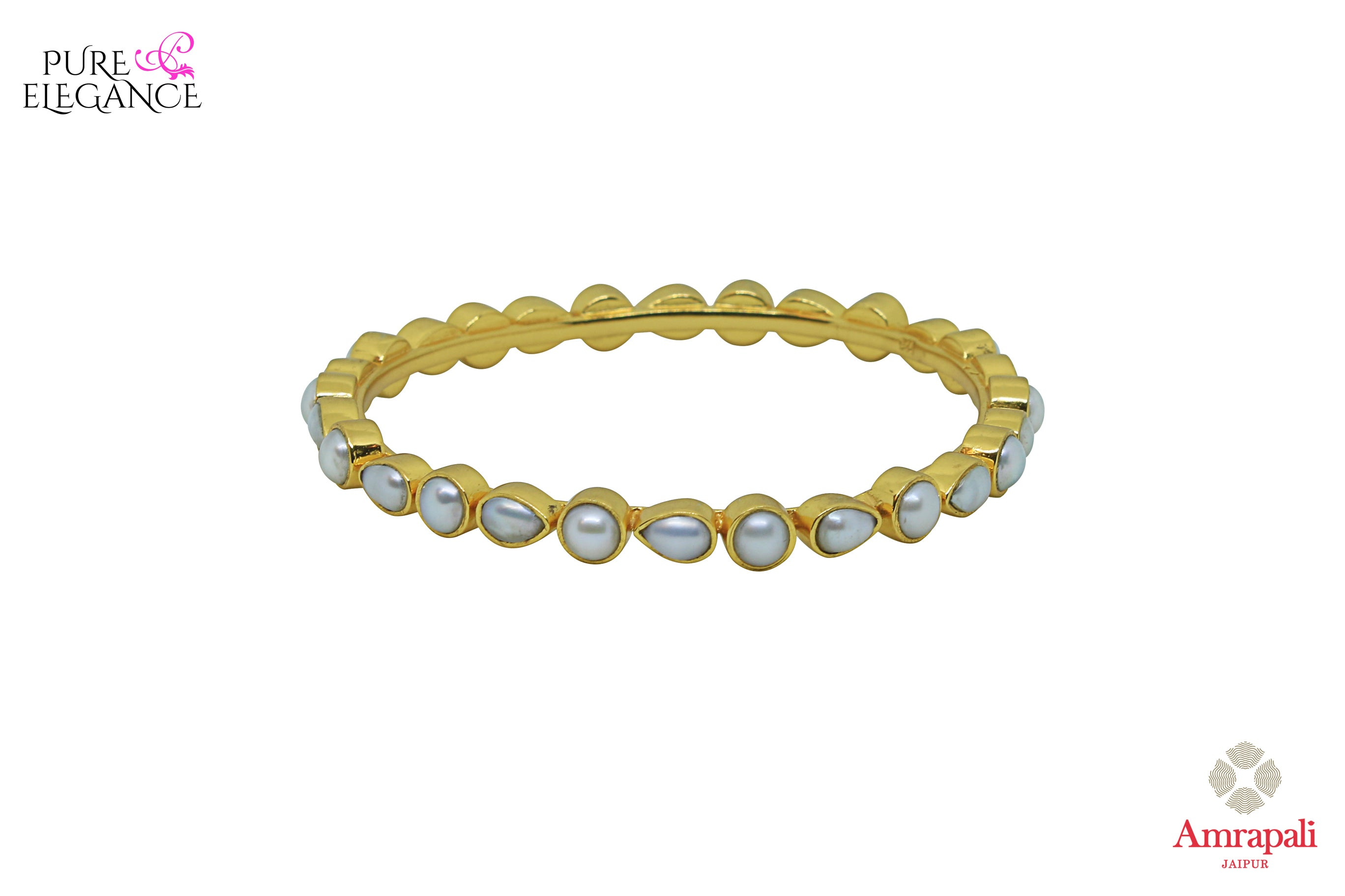Shop Amrapali silver gold plated pearl bangle with online in USA. Find an exquisite collection of handcrafted silver gold plated jewelry in USA at Pure Elegance Indian fashion store. Complete your festive look with traditional Indian jewelry, silver gold plated earrings, silver jewellery from our online store.-front