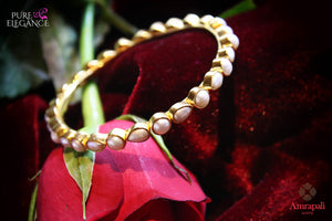 Shop Amrapali silver gold plated pearl bangle with online in USA. Find an exquisite collection of handcrafted silver gold plated jewelry in USA at Pure Elegance Indian fashion store. Complete your festive look with traditional Indian jewelry, silver gold plated earrings, silver jewellery from our online store.-flatlay