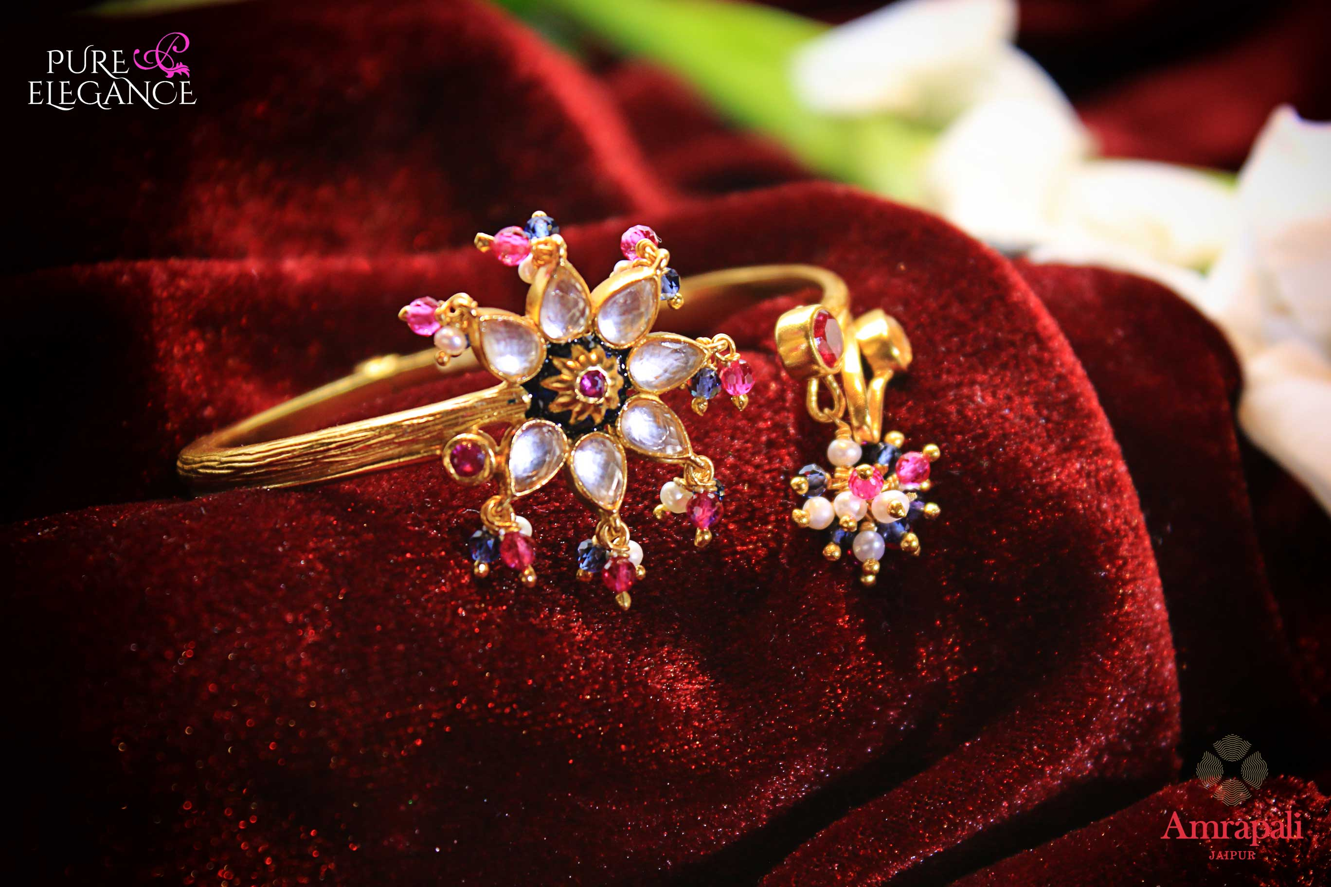 Buy silver gold plated floral bangle online in USA. Bring out the best in your ethnic look with traditional Indian jewellery available at Pure Elegance fashion store in USA. We have a stunning variety of silver gold plated jewelry by Amrapali also available at our online store. Shop now.-full view