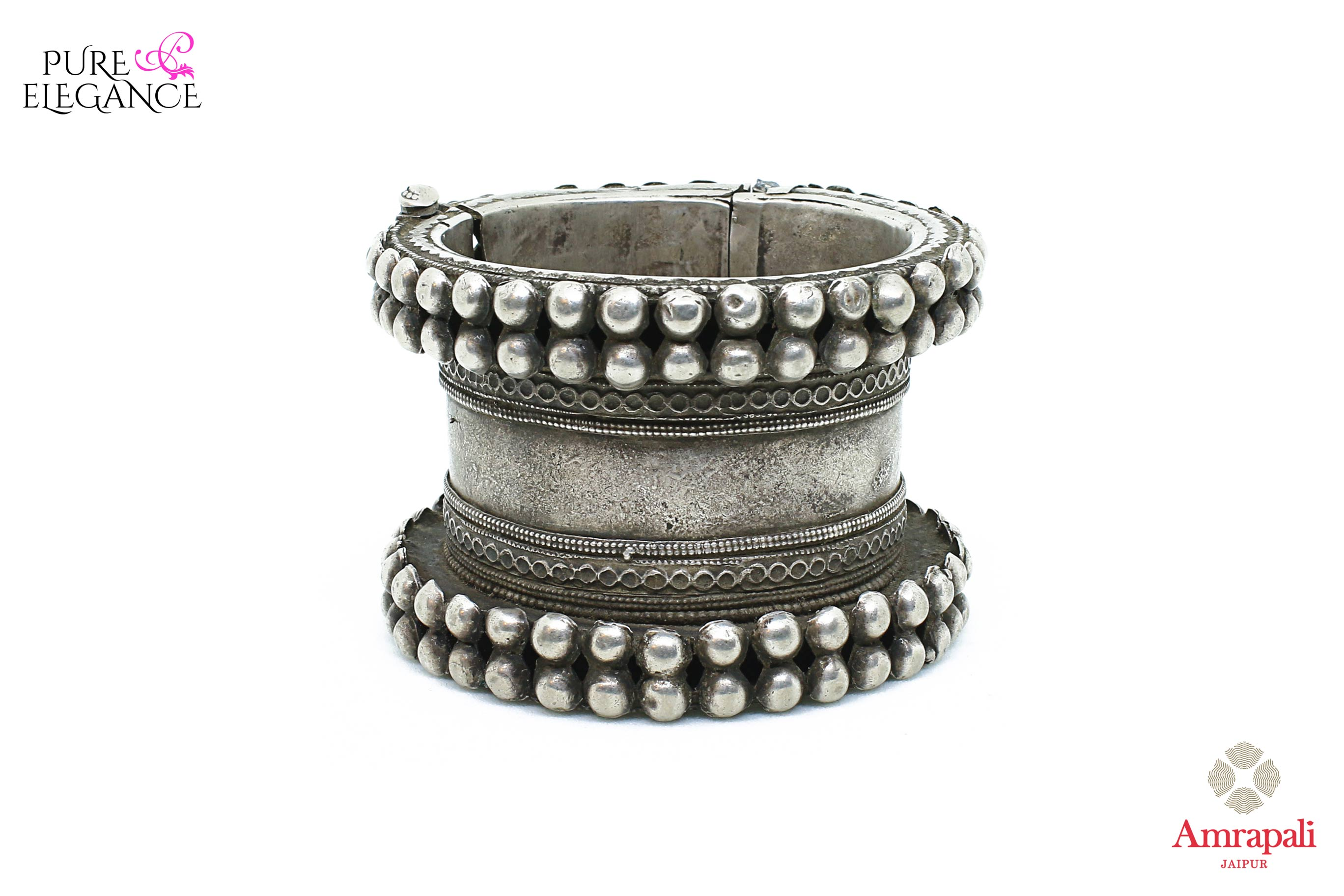 Buy beautiful Amrapali handcrafted heavy silver bangle online in USA. Find an exquisite collection of handcrafted silver gold plated jewelry in USA at Pure Elegance Indian fashion store. Complete your festive look with traditional Indian jewelry, silver gold plated earrings, silver jewellery from our online store.-front