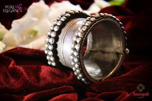 Buy beautiful Amrapali handcrafted heavy silver bangle online in USA. Find an exquisite collection of handcrafted silver gold plated jewelry in USA at Pure Elegance Indian fashion store. Complete your festive look with traditional Indian jewelry, silver gold plated earrings, silver jewellery from our online store.-flatlay