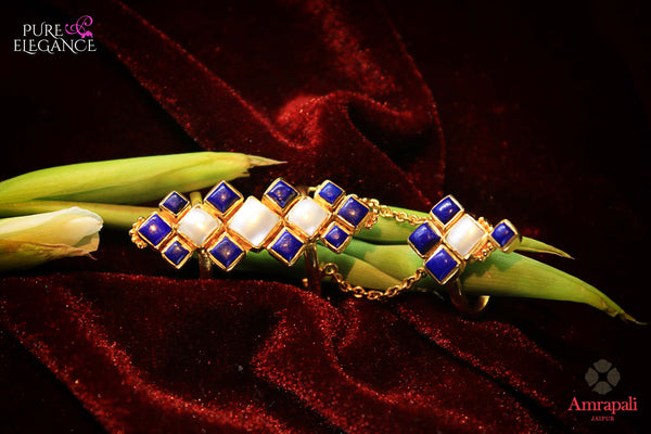 Shop Amrapali silver gold plated lapis and pearl ring online in USA. Find an exquisite collection of handcrafted silver gold plated jewelry in USA at Pure Elegance Indian fashion store. Complete your festive look with traditional Indian jewelry, silver gold plated earrings, silver jewellery from our online store.-flatlay