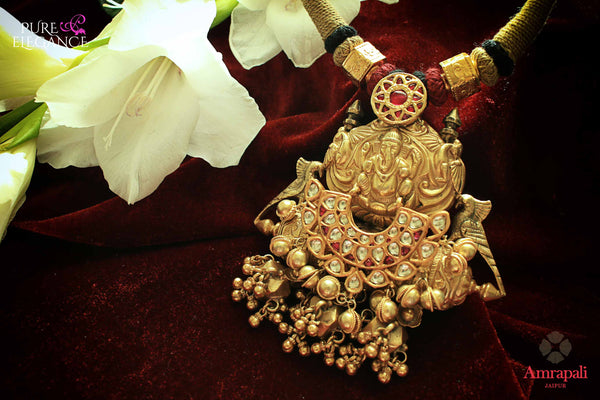 Buy Amrapali silver gold plated thread necklace online in USA with traditional Ganesha pendant. Get your hands on an alluring range of Indian necklaces from Amrapali in USA. Add extra edge to your ethnic look with Indian fashion jewellery available at Pure Elegance Indian fashion store in USA.-flatlay