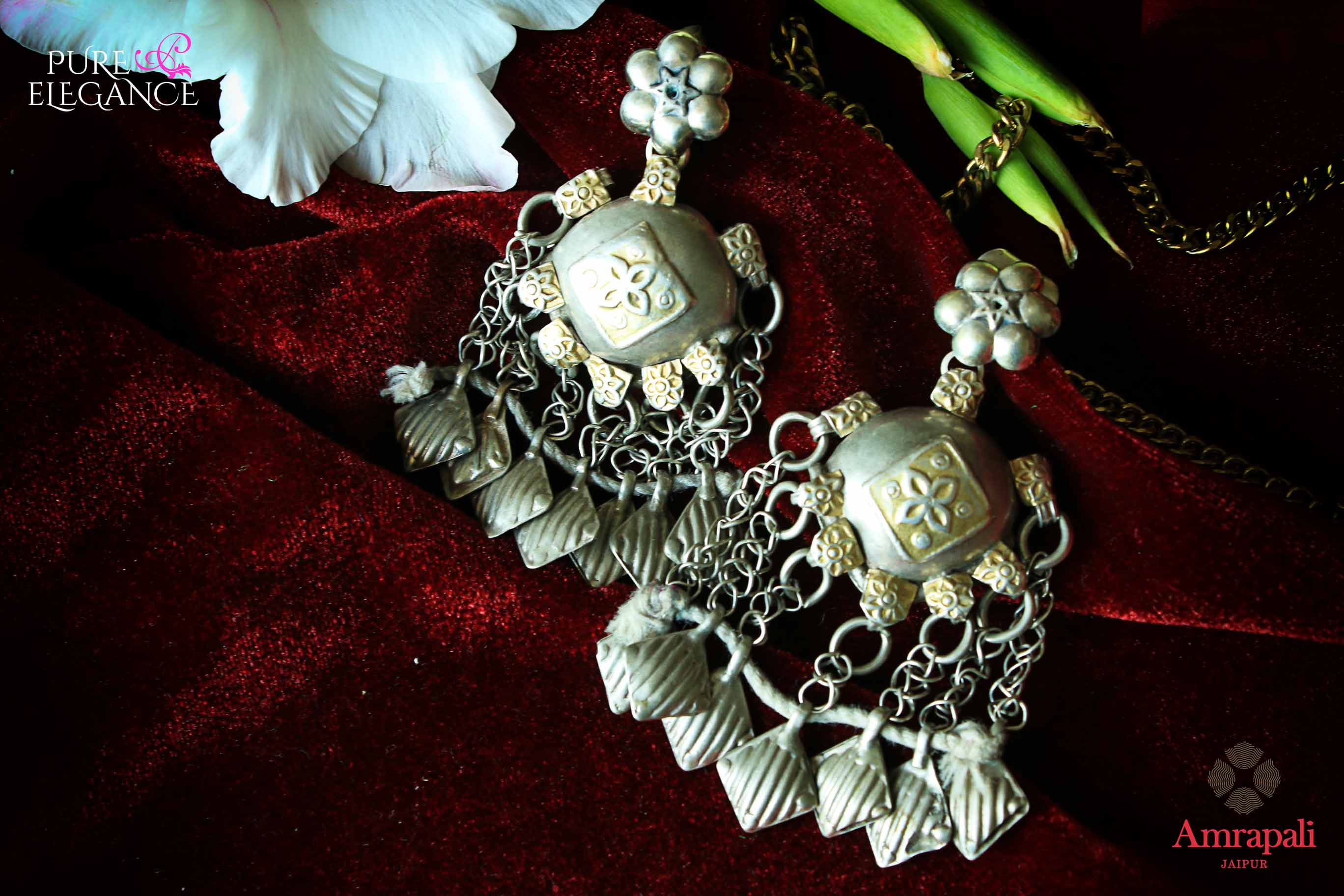 Shop silver handcrafted tribal earrings with tassels online in USA. Find an exquisite collection of handcrafted Indian jewelry in USA at Pure Elegance Indian fashion store. Complete your festive look with beautiful silver gold plated necklaces, silver gold plated earrings, silver jewelry from our online store.-flatlay