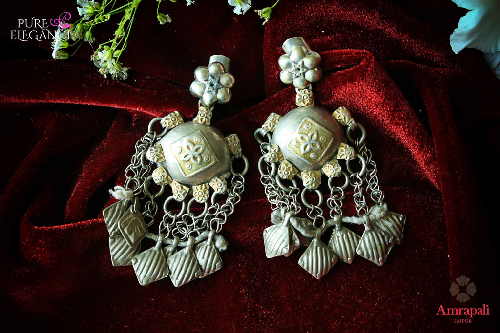 Buy alluring silver handcrafted tribal earrings online in USA with tassels . Find an exquisite collection of handcrafted Indian jewelry in USA at Pure Elegance Indian fashion store. Complete your festive look with beautiful silver gold plated necklaces, silver gold plated earrings, silver jewelry from our online store.-flatlay