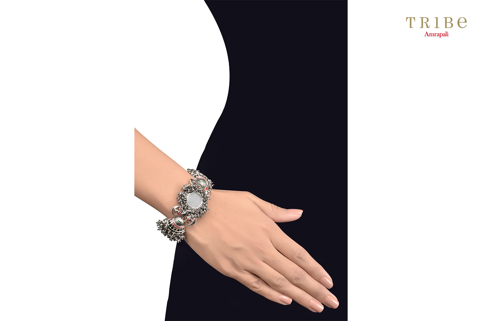 Buy Amrapali fan motif mirror enameled silver bracelet online in USA. Add a sparkling touch to your ethnic look with beautiful Indian ethnic jewelry available at Pure Elegance exclusive Indian fashion store in USA or shop online.-hand view