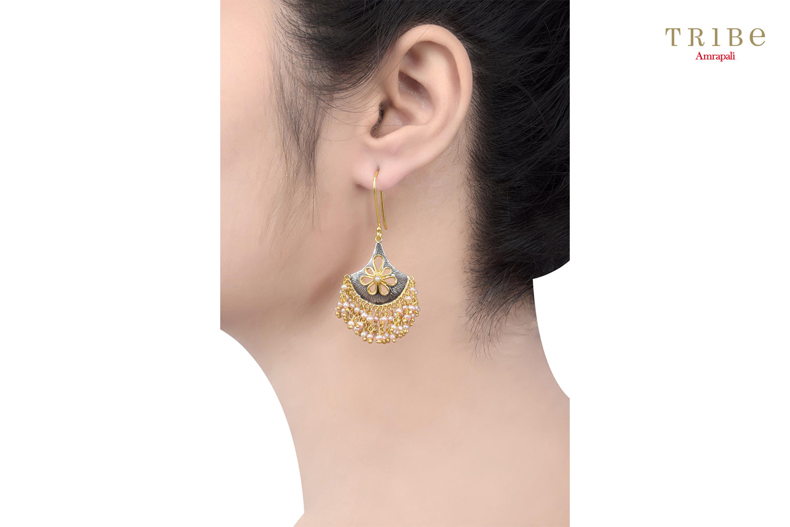 Buy silver dual tone flower pearl droplet earrings online in USA by Amrapali. Adorn your Indian traditional look with an exquisite range of Indian silver gold plated jewellery available at Pure Elegance fashion store in USA or shop online. -ear view