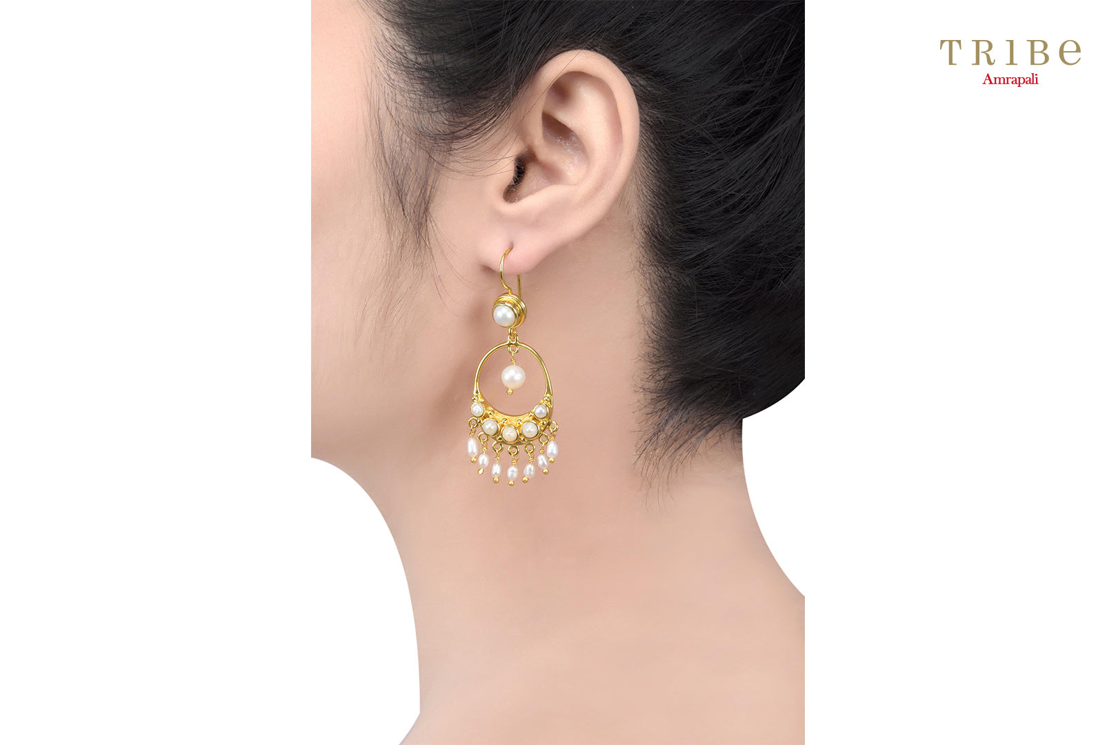 Buy silver gold plated pearl round droplet hook earrings online in USA by Amrapali. Adorn your Indian traditional look with an exquisite range of Indian silver gold plated jewellery available at Pure Elegance fashion store in USA or shop online. -ear view