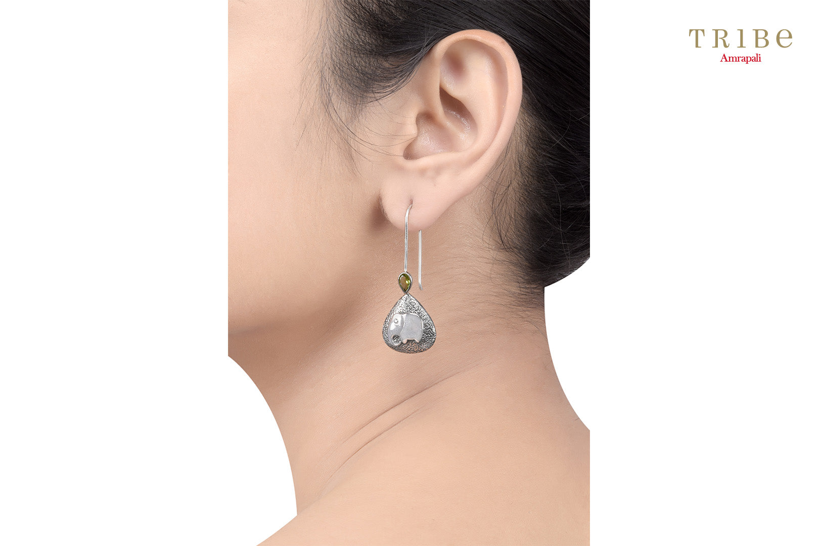 Buy silver elephant hook earrings online in USA by Amrapali. Adorn your Indian traditional look with an exquisite range of Indian silver jewelry available at Pure Elegance fashion store in USA or shop online. -ear view