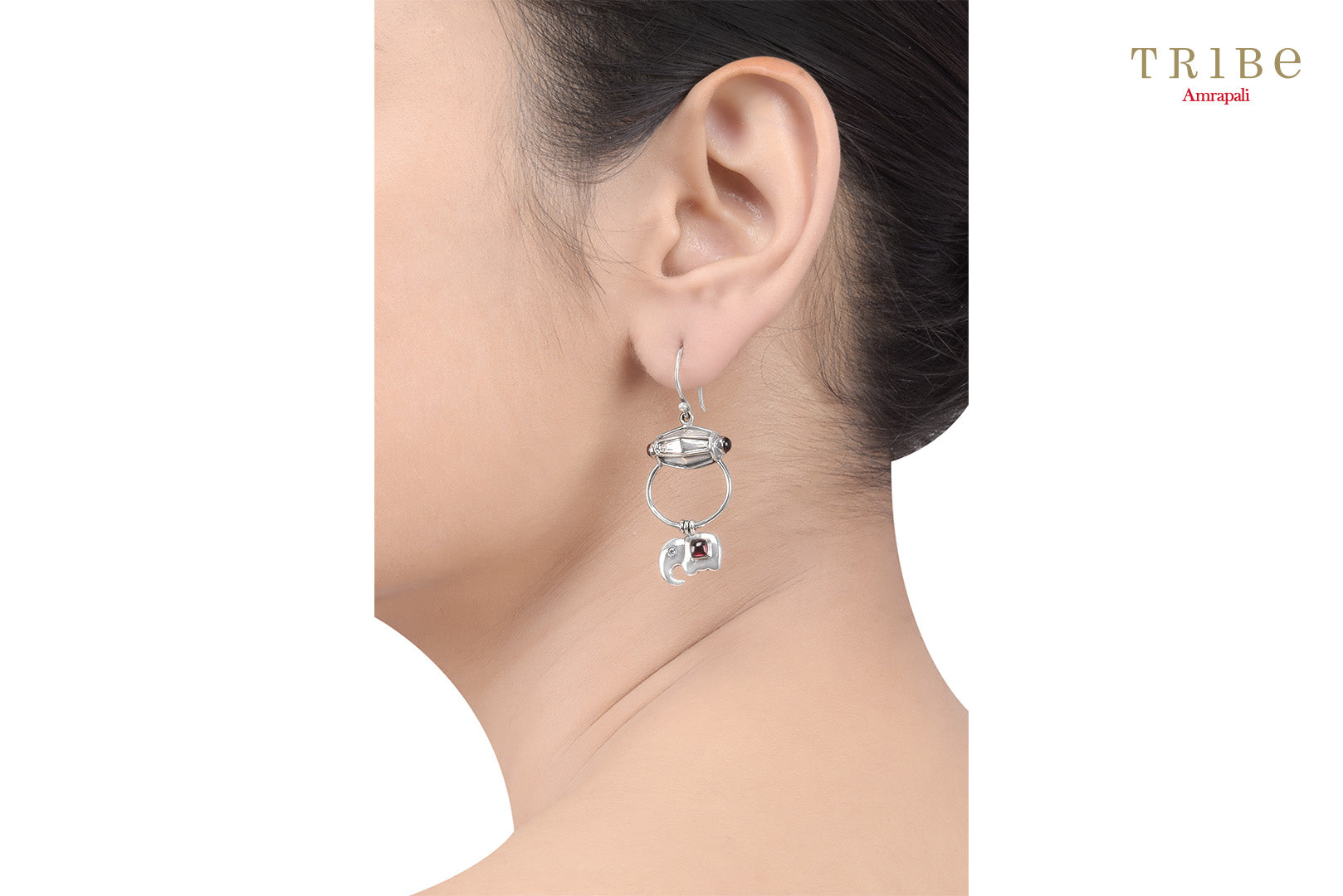 Shop silver drum elephant drop garnet earrings online in USA by Amrapali. Adorn your Indian traditional look with an exquisite range of Indian silver jewelry available at Pure Elegance fashion store in USA or shop online. -ear view