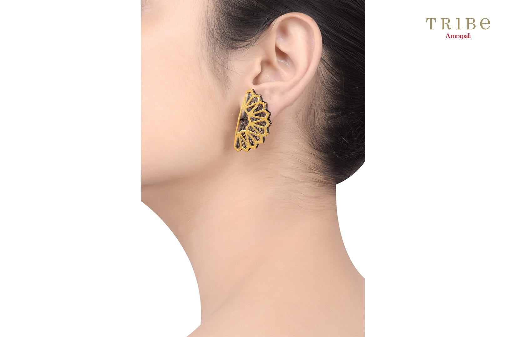 Shop online Silver Dual Tone Fan Motif Earrings in USA by Amrapali. Adorn your Indian traditional look with an exquisite range of Indian silver gold plated earrings available at Pure Elegance fashion store in USA or shop online. -ear view