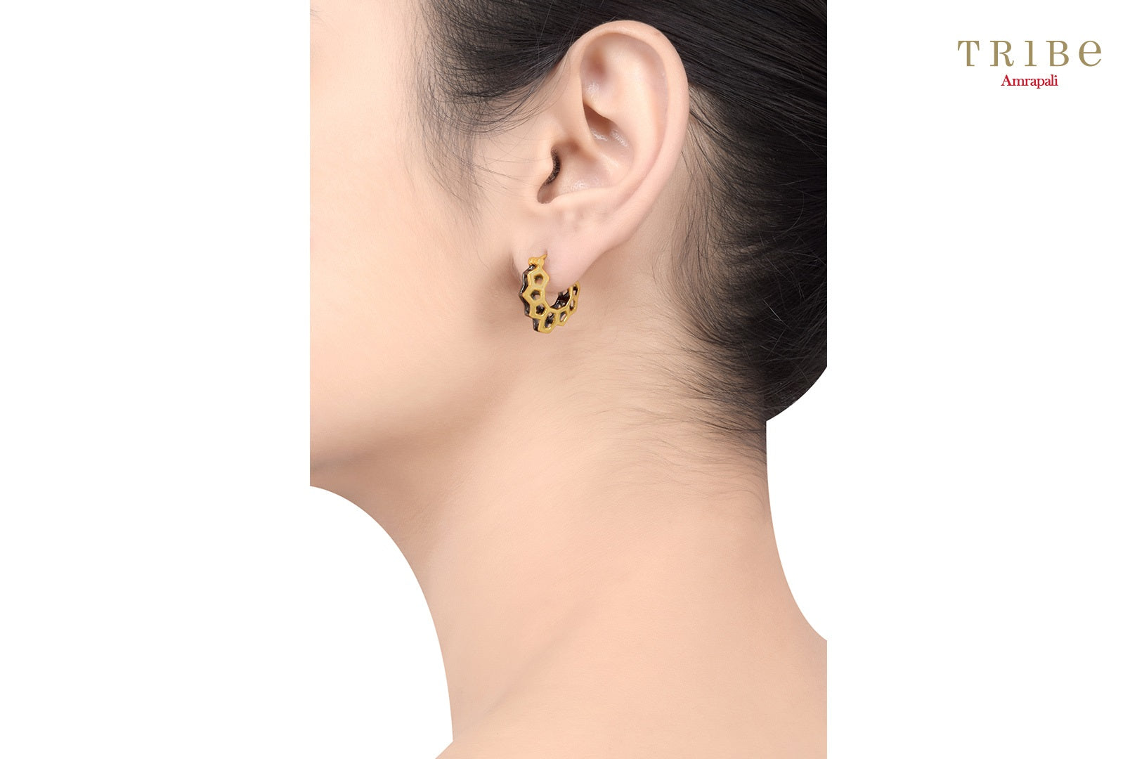 Buy Silver Dual Tone Hexagon Pentagon Earrings online in USA by Amrapali. Adorn your Indian traditional look with an exquisite range of Indian silver gold plated jewellery available at Pure Elegance fashion store in USA or shop online. -Ear view
