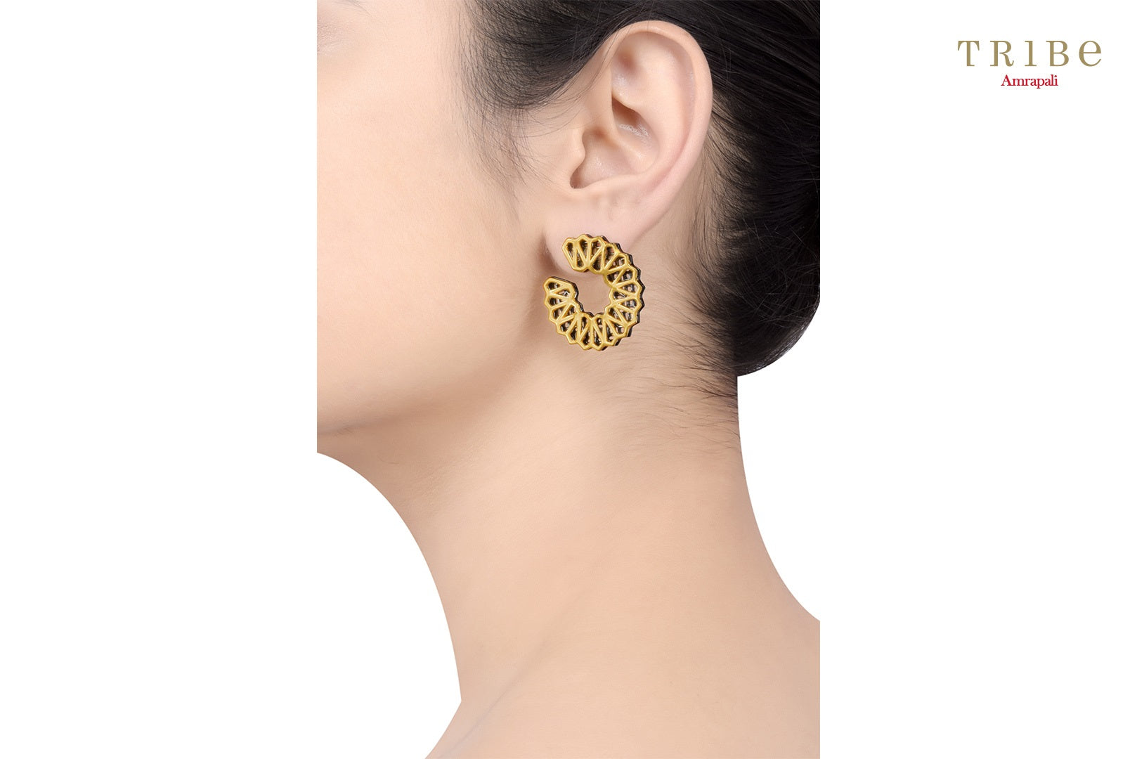 Shop online Silver Dual Tone Circular High Low Ear studs in USA by Amrapali. Adorn your Indian traditional look with an exquisite range of Indian silver gold plated earrings available at Pure Elegance fashion store in USA or shop online. -ear view
