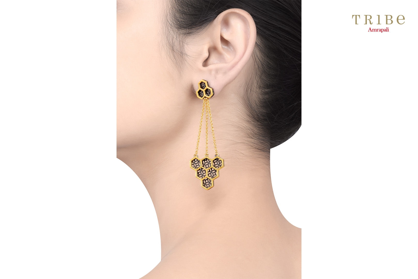 Shop online Silver Dual Tone Hexagon Honeycomb Earrings in USA by Amrapali. Adorn your Indian traditional look with an exquisite range of Indian silver gold plated jewelry available at Pure Elegance fashion store in USA or shop online. -ear view