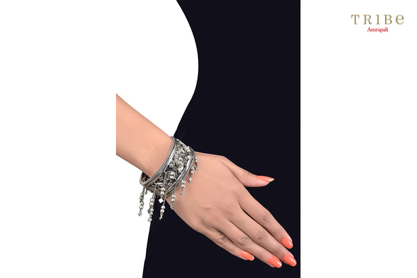 Buy Silver Oxidized Rhomb Tassel Drop Textured Mirror Bangle online in USA by Amrapali. Adorn your Indian traditional look with an exquisite range of Indian silver gold plated jewelry available at Pure Elegance fashion store in USA or shop online. -hand view