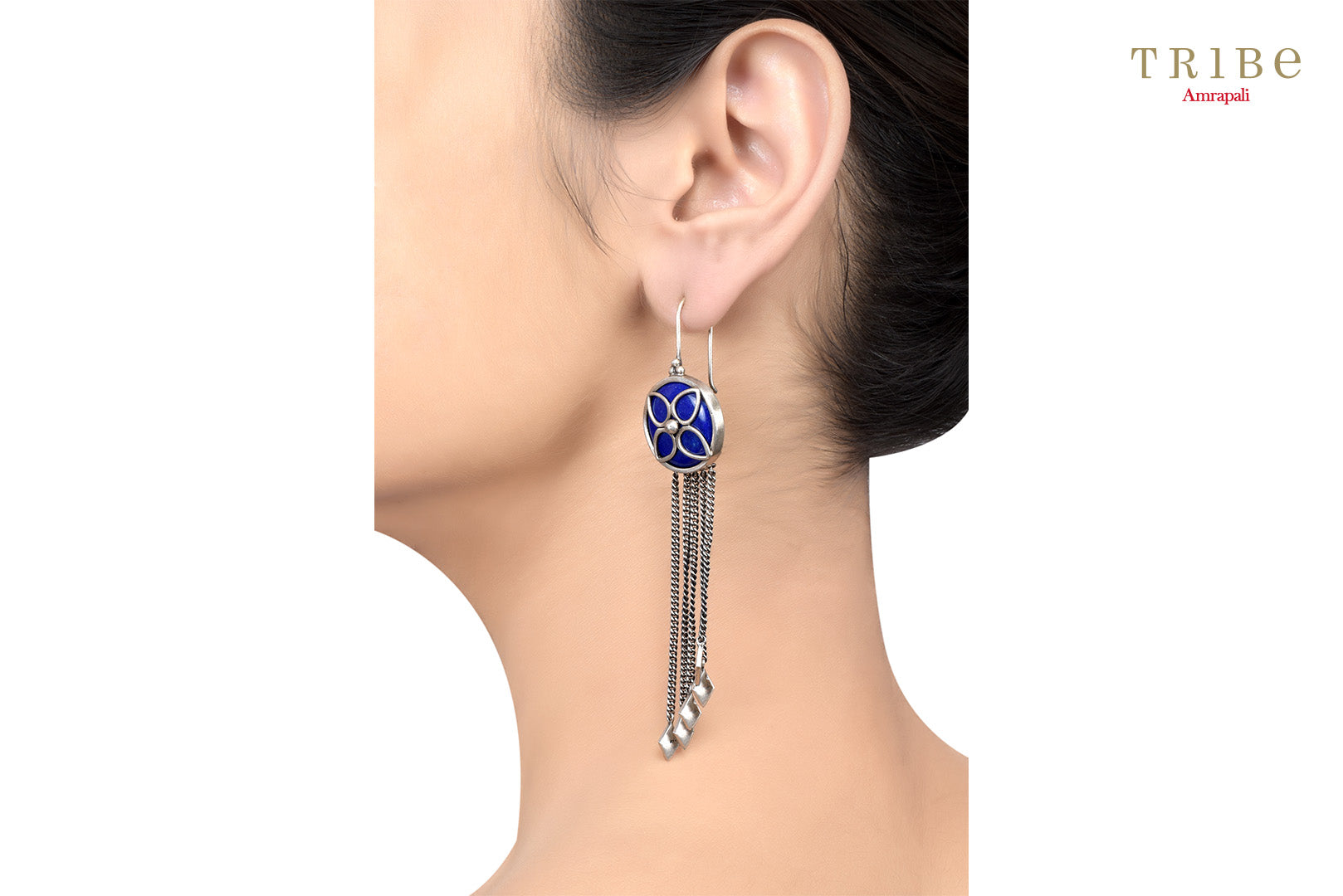 Shop Silver Floral Lapis Tassel Hanging Rhombus Earrings online in USA by Amrapali. Adorn your Indian traditional look with an exquisite range of Indian silver gold plated jewelry available at Pure Elegance fashion store in USA or shop online. -Ear view