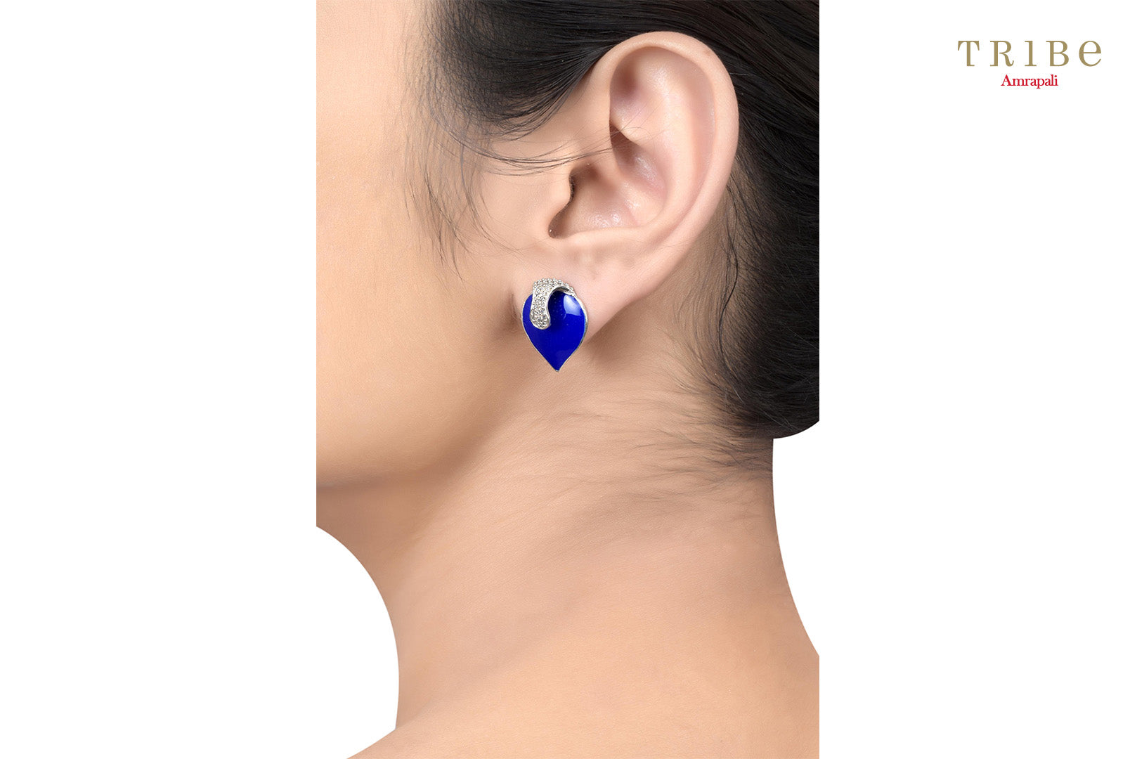 Shop Silver Leafy Zircon Lapis Enameled Ear Studs online in USA by Amrapali. Adorn your Indian traditional look with an exquisite range of Indian silver gold plated jewelry available at Pure Elegance fashion store in USA or shop online. -ear view