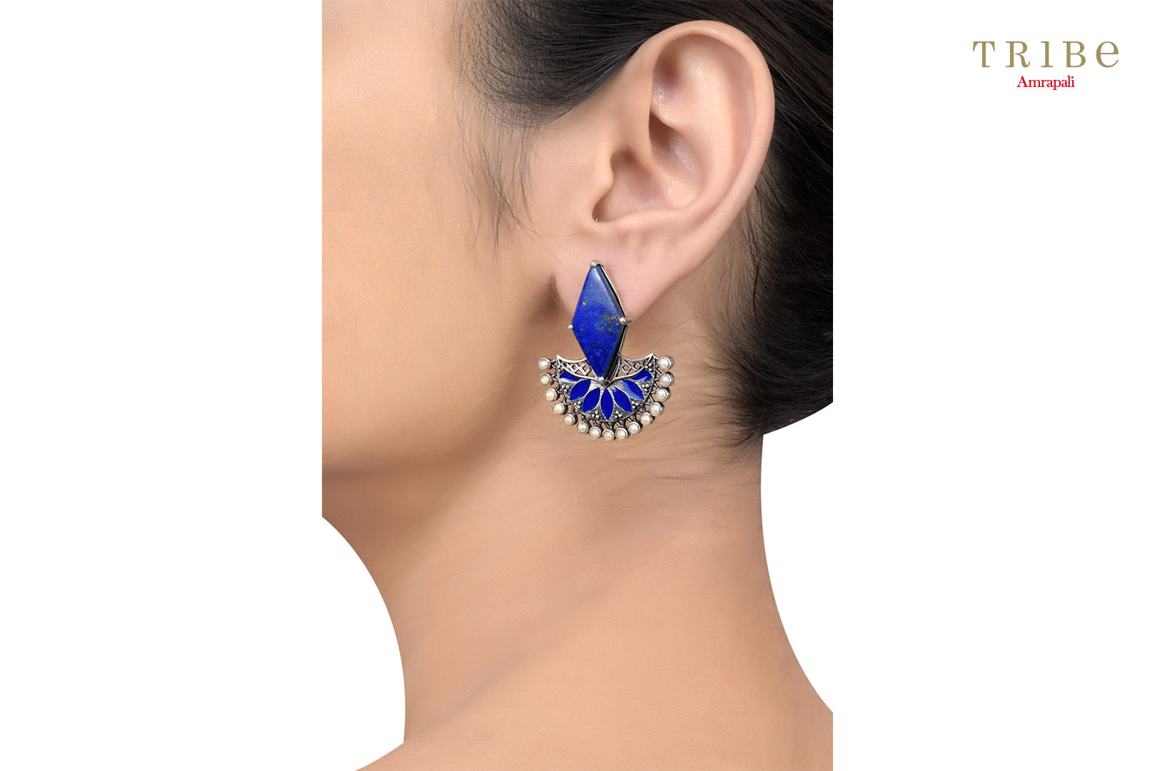 Shop Silver Rhombus Lapis Floral Pearl Enameled Earrings online in USA by Amrapali. Adorn your Indian traditional look with an exquisite range of Indian silver gold plated jewelry available at Pure Elegance fashion store in USA or shop online. -ear view