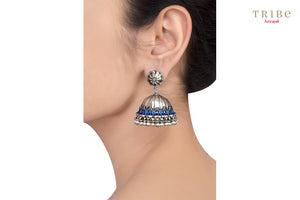 Shop Silver Oxidized Floral Blue Enamel Rawa Dome Jhumka Earrings online in USA by Amrapali. Adorn your Indian traditional look with an exquisite range of Indian silver gold plated jewelry available at Pure Elegance fashion store in USA or shop online. -ear view
