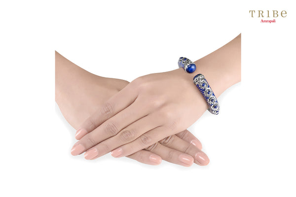 Shop online Silver Enameled Lapis Flower Bangles in USA by Amrapali. Adorn your Indian traditional look with an exquisite range of Indian silver gold plated jewelry available at Pure Elegance fashion store in USA or shop online. -hand view