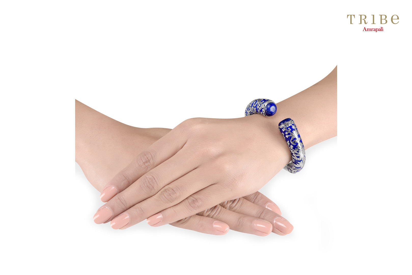 Shop online Silver Navy Enamel Leafy Lapis Bangle in USA by Amrapali. Adorn your Indian traditional look with an exquisite range of Indian silver gold plated jewelry available at Pure Elegance fashion store in USA or shop online. -hand view