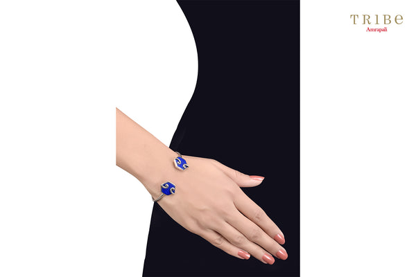 Shop online Silver Hexagon Motif Lapis Bracelet in USA by Amrapali. Adorn your Indian traditional look with an exquisite range of Indian silver gold plated jewelry available at Pure Elegance fashion store in USA or shop online. -hand view