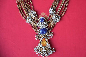 Shop silver gold plated multi chain Amrapali necklace online in USA with lapis and citrine pendant. Add spark to your ethnic attires with beautiful Indian jewelry, wedding jewelry, silver gold plated necklaces from Pure Elegance Indian fashion store in USA.-flatlay