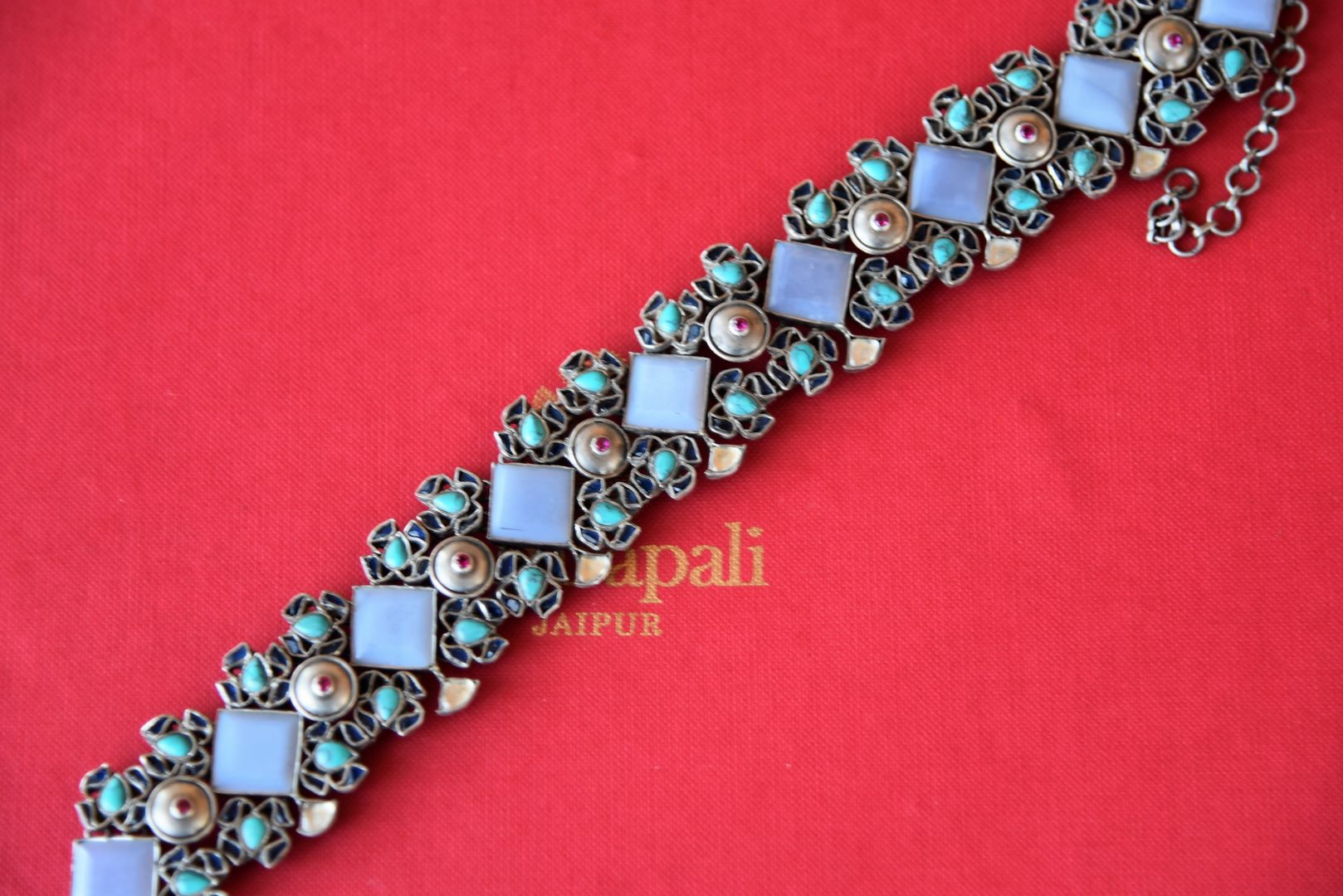 Buy Amrapali geometric design silver necklace online in USA with embedded blue stones. Add spark to your ethnic attires with beautiful Indian silver jewelry, wedding jewelry, silver gold plated necklaces from Pure Elegance Indian fashion store in USA.-flatlay