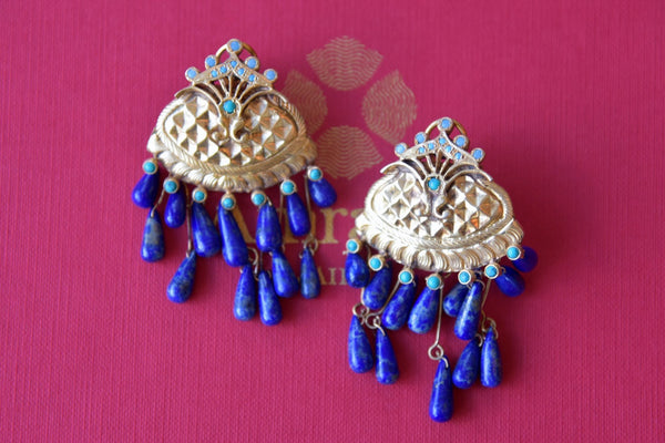 Buy Amrapali silver gold plated earrings with lapis tassels online in USA. Find an exquisite collection of handcrafted silver gold plated jewelry in USA at Pure Elegance Indian fashion store. Complete your festive look with traditional Indian jewellery, silver gold plated earrings, silver jewellery from our online store.-flatlay