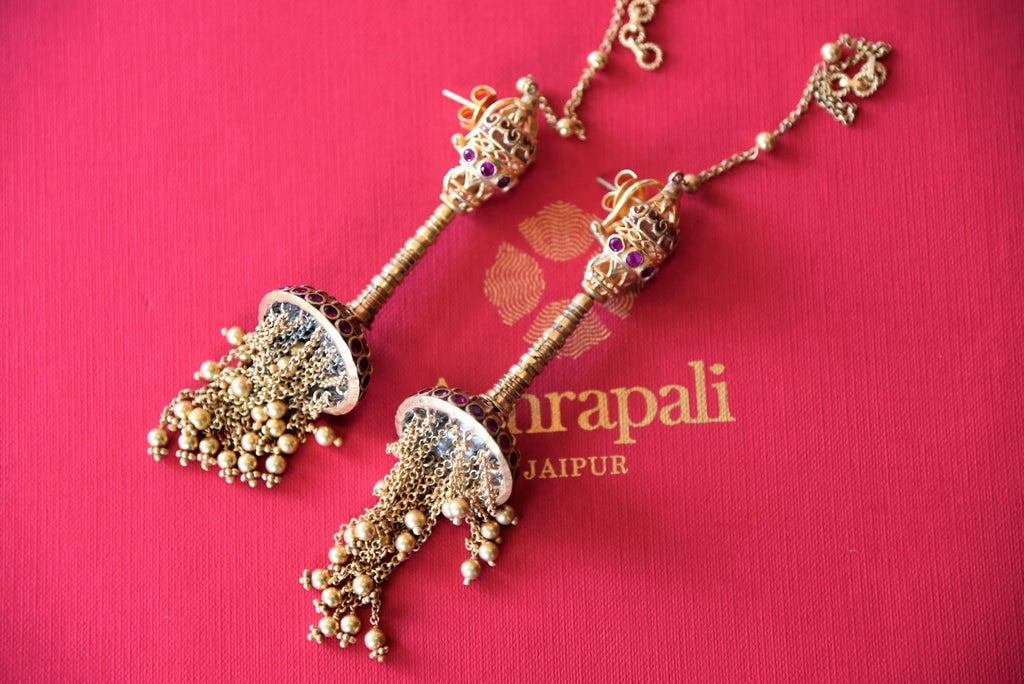 Shop delicate silver gold plated Amrapali jhumki earrings with tassels online in USA from Pure Elegance. Complete your traditional look with an exquisite collection of Indian silver gold plated jewelry, wedding jewellery, silver gold plated earrings and much more from our Indian fashion store in USA.  -flatlay