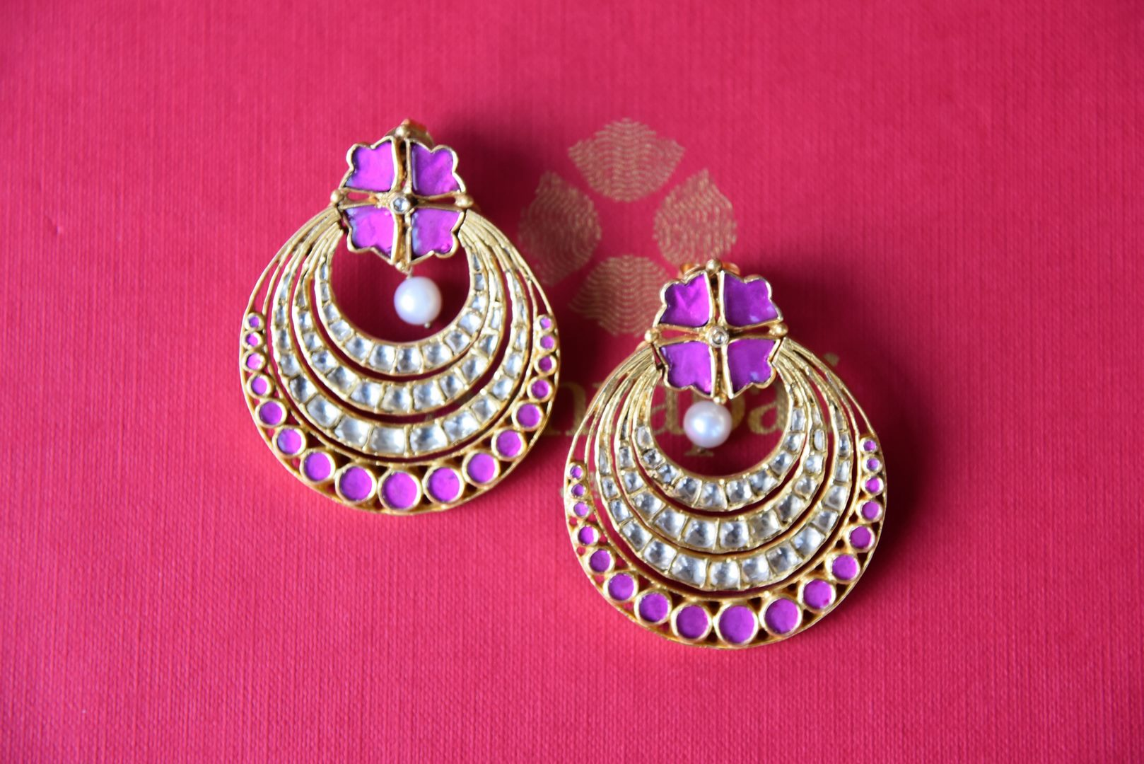 Shop silver gold plated round earrings by Amrapali online in USA with white and pink glass. Get festival ready with a range of exquisite handcrafted Indian silver gold plated jewelry from Pure Elegance Indian clothing store in USA.-flatlay