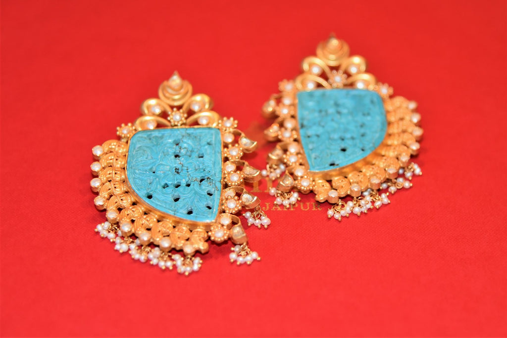 Buy silver gold plated Amrapali pearl earrings online in USA with engraved turquoise stone from Pure Elegance. Complete your traditional look with an exquisite collection of Indian silver gold plated jewelry, wedding jewellery, silver gold plated earrings and much more from our Indian fashion store in USA. -flatlay
