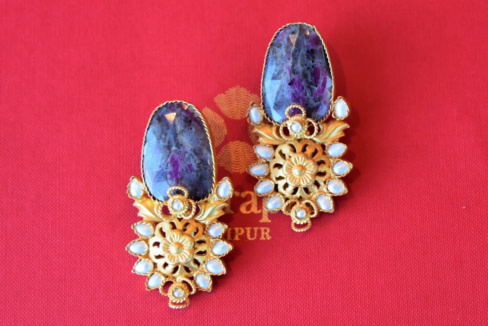 Shop Amrapali beautiful silver gold plated pearl earrings online in USA with blue stone. Add spark to your ethnic attires with beautiful Indian silver gold plated jewelry, wedding jewelry, silver gold plated necklaces from Pure Elegance Indian fashion store in USA.-flatlay
