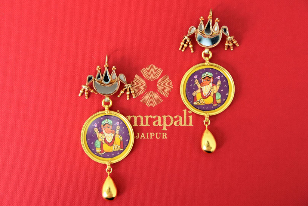 Buy Amrapali silver gold plated blue glass earrings online in USA with Lord Ganesha painting. Find an exquisite collection of handcrafted Indian jewellery in USA at Pure Elegance Indian fashion store. Complete your festive look with beautiful silver gold plated necklaces, silver gold plated earrings, silver jewelry from our online store.-flatlay