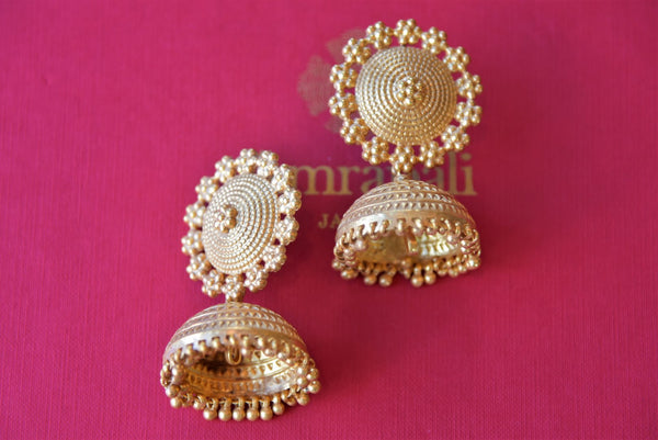 Buy ethnic Amrapali silver gold plated jhumki earrings online in USA. Find an exquisite collection of handcrafted silver gold plated jewelry in USA at Pure Elegance Indian fashion store. Complete your festive look with traditional Indian jewellery, silver gold plated earrings, silver jewellery from our online store.-flatlay