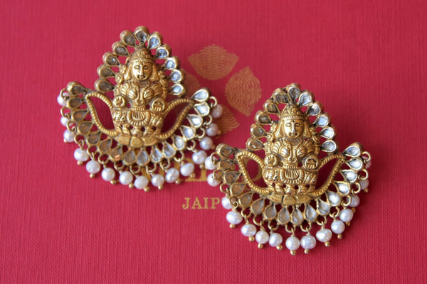 Buy Amrapali silver gold plated glass earrings with engraved Goddess Lakshmi online in USA. Find an exquisite collection of handcrafted silver gold plated jewelry in USA at Pure Elegance Indian fashion store. Complete your festive look with traditional Indian jewellery, silver gold plated earrings, silver jewellery from our online store.-flatlay