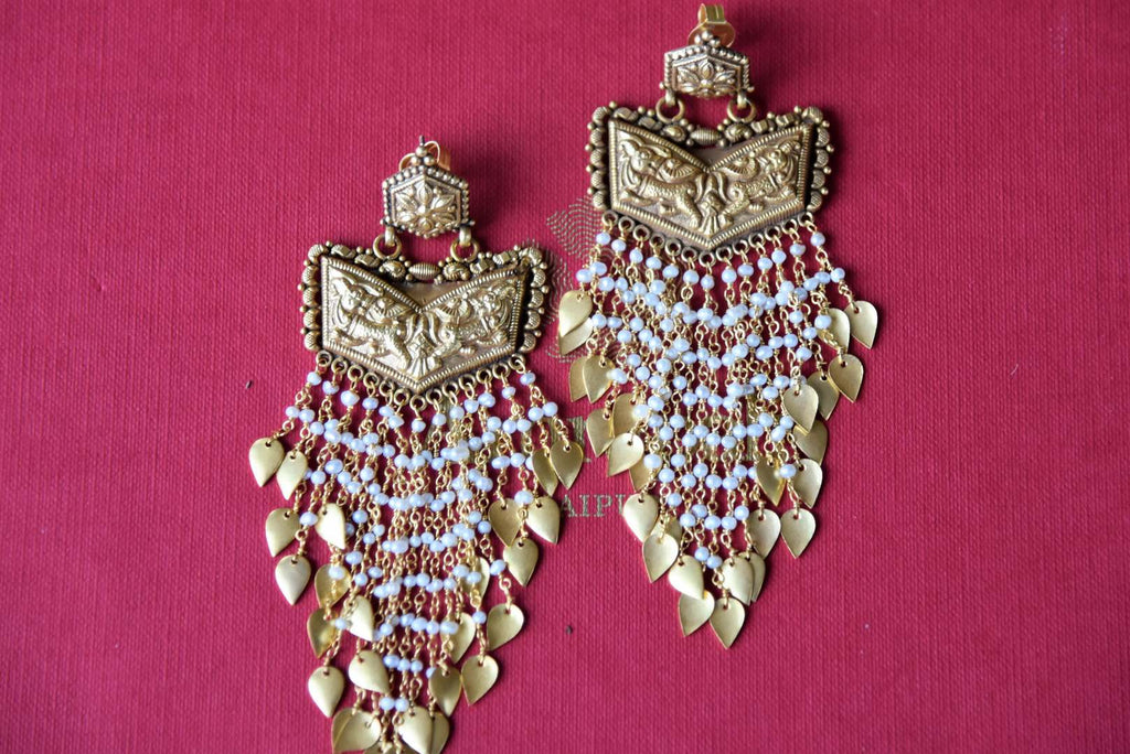 Buy silver gold plated Amrapali textured earrings online in USA with pearls and gold leaf tassels. Get festival ready with a range of exquisite handcrafted Indian silver gold plated jewelry, ethnic silver jewelry from Pure Elegance Indian clothing store in USA.-flatlay