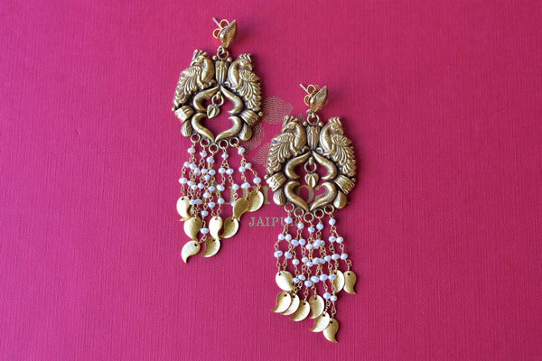 Shop Amrapali silver gold plated peacock earrings with pearl tassels online in USA. Find an exquisite collection of handcrafted silver gold plated jewelry in USA at Pure Elegance Indian fashion store. Complete your festive look with traditional Indian jewellery, silver gold plated earrings, silver jewellery from our online store.-flatlay