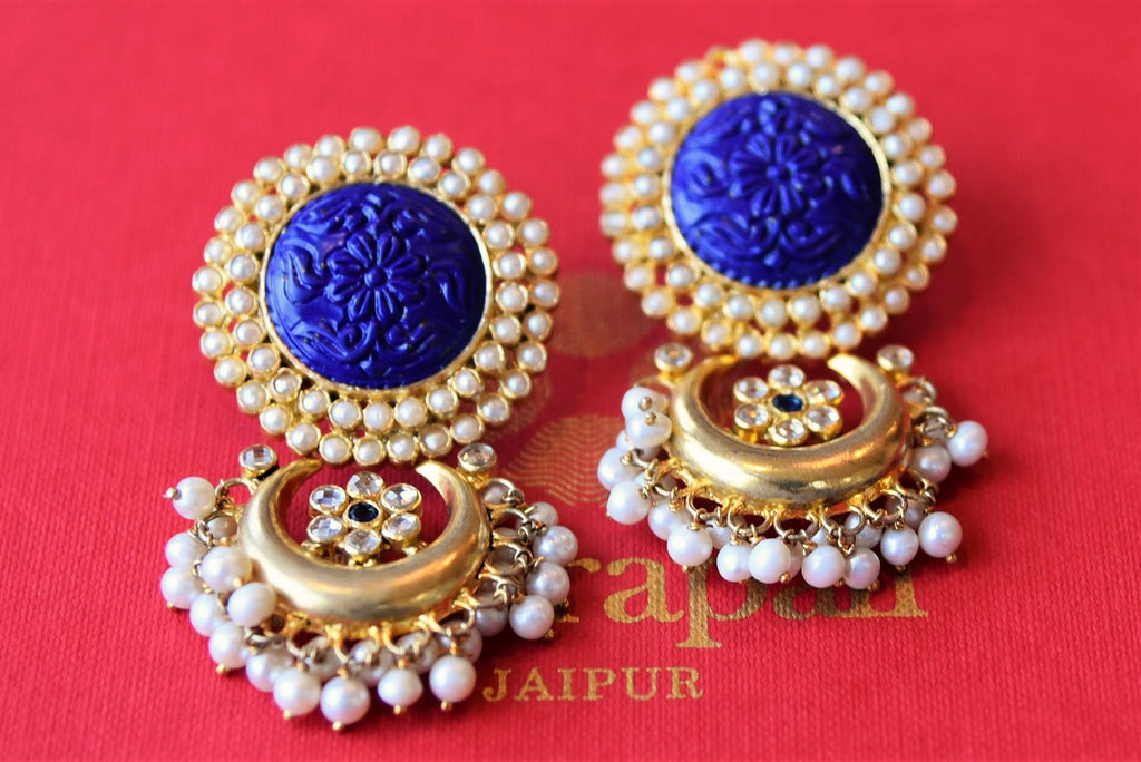 Shop Amrapali silver gold plated glass and engraved blue stone earrings with pearls online in USA from Pure Elegance. Complete your traditional look with an exclusive collection of Indian jewelry, silver gold plated necklaces, wedding jewellery available at our exclusive Indian fashion store in USA and also on our online store. Shop now.-flatlay