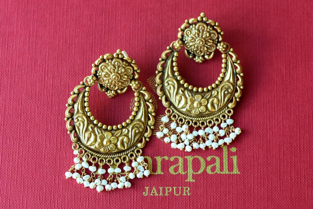 Shop Amrapali silver gold plated oxidized chandbali earrings with pearls online in USA. Find an exquisite collection of handcrafted silver gold plated jewelry in USA at Pure Elegance Indian fashion store. Complete your festive look with traditional Indian jewellery, silver gold plated earrings, silver jewelry from our online store.-flatlay