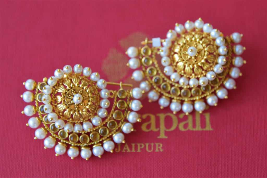 Shop Amrapali silver gold plated crescent shape earrings with pearls online in USA. Find an exquisite collection of handcrafted silver gold plated jewelry in USA at Pure Elegance Indian fashion store. Complete your festive look with traditional Indian jewellery, silver gold plated earrings, silver jewelry from our online store.-flatlay