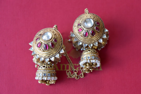 Buy Amrapali silver gold plated white and pink glass jhumki with pearls online in USA. Find an exquisite collection of handcrafted silver gold plated jewelry in USA at Pure Elegance Indian fashion store. Complete your festive look with traditional Indian jewellery, silver gold plated earrings, silver jewelry from our online store.-flatlay